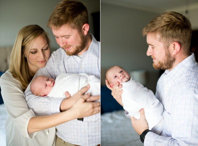 mom and dad with new baby boy at home