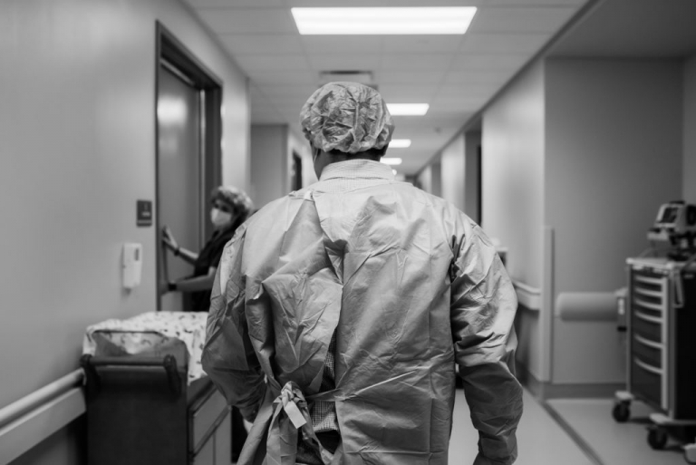 father walking into c-section for birth story bham al